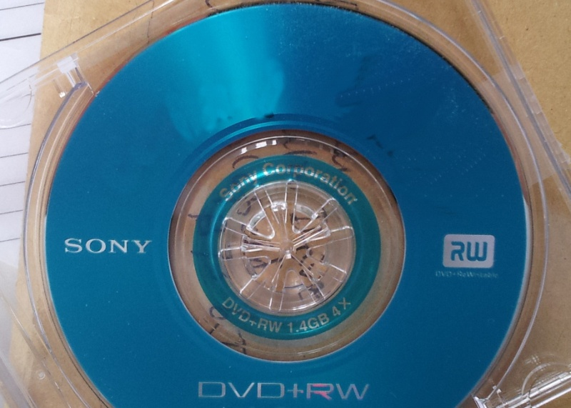 A Sony DVD disk shown inserted in it's mini case. The 8cm disk is a blue DVD+RW and could not be finalised.