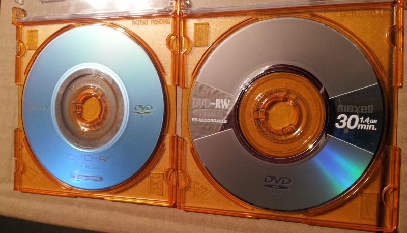 A mini Sony DVD-R shown alongside a Maxell DVD-R. Both discs were used in handycam video recorders reporting corrupt video files. The disks were sent to us to recover the video clips.
