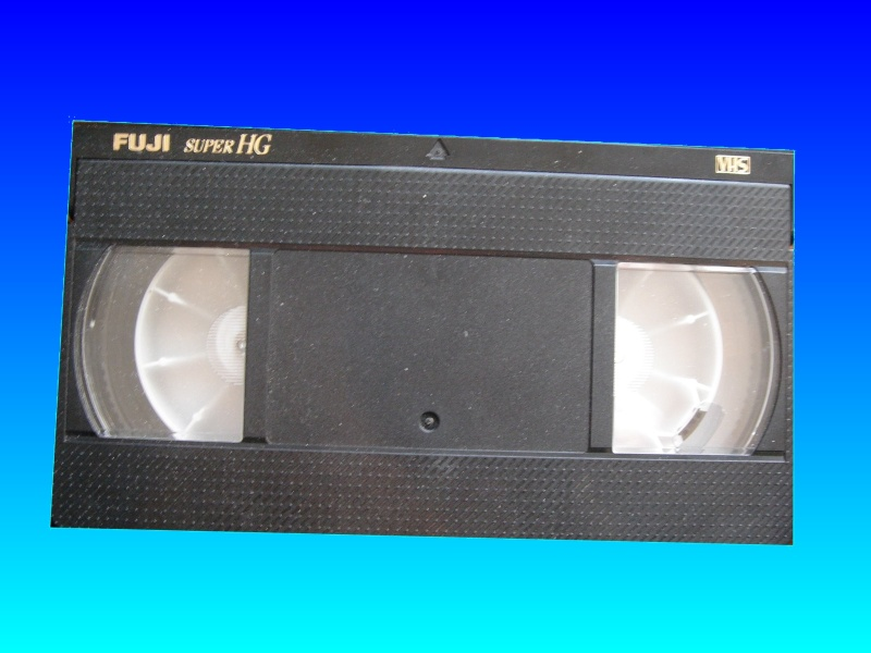 A VHS E-180 tape - probably the most popular tape size out there! This one was by Fuji but I seem to recall Scotch were the main brand in our house. This one contained home movies that required transfer to DVD or video files for storage on USB drive or Hard Disk.