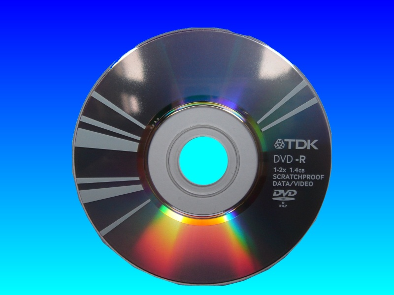 This TDK mini DVD disc was used in a Panasonic camcorder. The disc was full of video but un-finalized so would not playback on other DVD recorders. It is shown diffracting the light off its reflective surface.