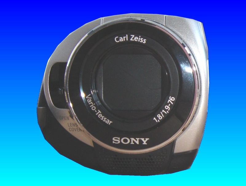 A Sony DCR HDD handycam shown with the lense cover closed, and facing directly towards the camera taking the shot. This type of camera records mpg files directly to an internal hard disk. We usually recover the video files to an external usb hard drive or flash stick.