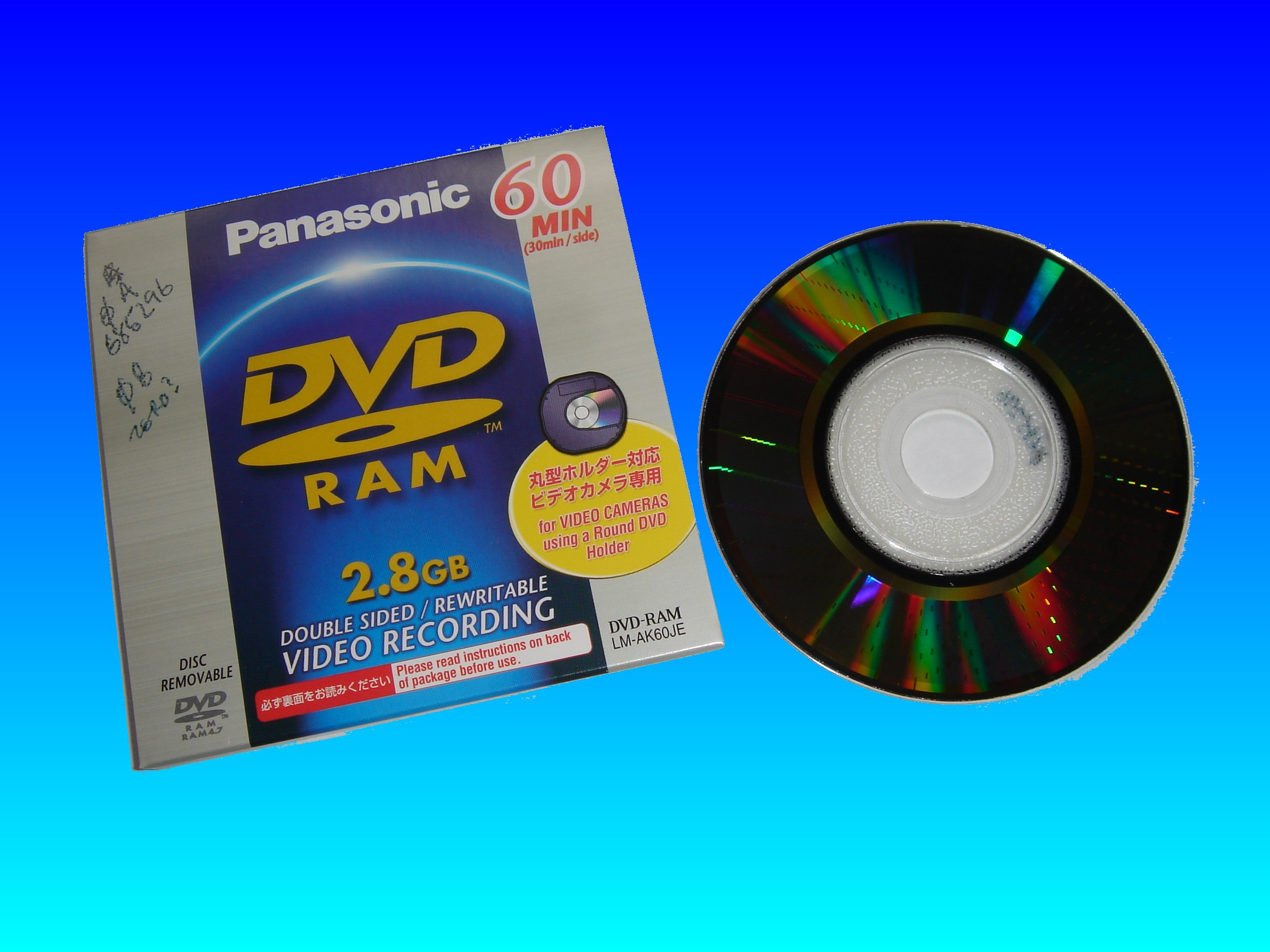 A Panasonic DVD-RAM cartridge used in Hitachi or Panasonic Video Cameras. The camocrder would record video directly to the disc. The disk surface where video was burnt can easily be seen as a darker area extending from the centre to the outer edge.
