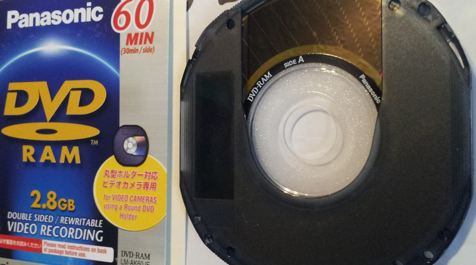A Panasonic DVD-RAM disc shown with its jewel case cover. The disc is double sided 60 minutes 2.8GB and was used on a camcorder to record films. The disc was sent to us to recover the videos.