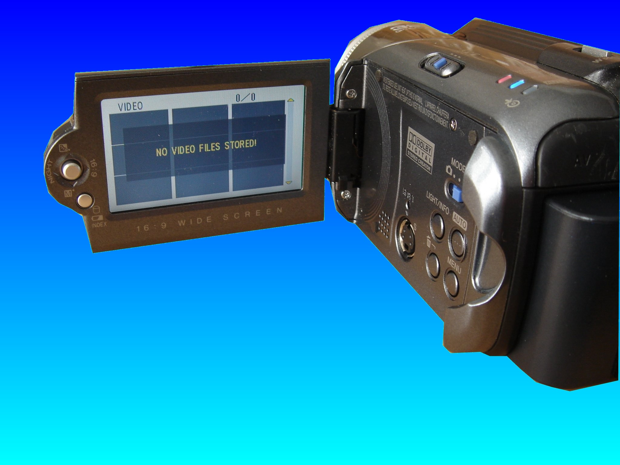 A JVC GZ-MG37U hard drive camcorder with the lcd display screen showing HDD error message. In this case the camera reports that no video files stored, and usually this is associated with hdd error as well.