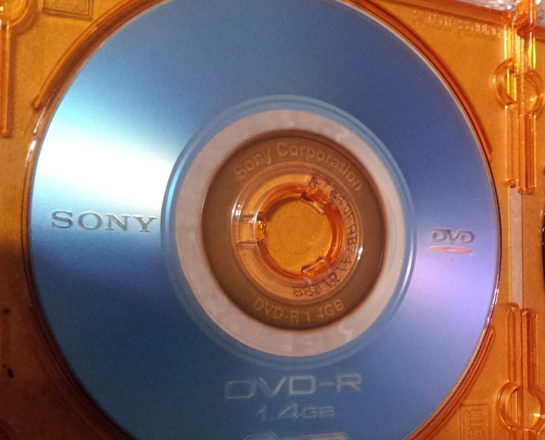 A Sony Mini DVD-R inside it's jewel case. This DVD was sent from East Syracuse, USA, where it had been used to record a friend's wedding video. The disc was used in a Sony Handycam and held 4 clips of the event, but was apprently corrupt and would only playback 2 of the clips.