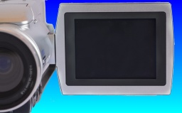 A camcorder with the lcd display screen pointing forwards. The camera can record video footage to dvd-rw disks.