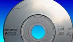 A Memorex dvd from a Canon DC210 camera that had the recording mode of disk error message. The disc is silver in colour with a purple dye recording layer.