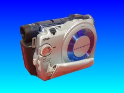 A camcorder or handycam shown with lense facing straight on to the camera. These use either hdd or dvd to capture video and store the recordings.