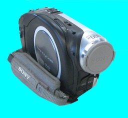 A Sony DCR-DVD handycam is shown in the photo against a blue background. The camera is forward facing and turned off with it's lense cover closed. This particular dvd cam was dropped and failed to finalize the disc.