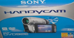 The photo shows the front of a Sony Handycam box. A picture of the camera is shown along with the mini DVDs that are used to save the recorded video footage. This particular is the DCR-DVD92E model.