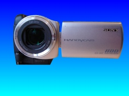 A Sony Handycam DCR-SR32E which required videos retrieved from the camera after it was accidentally reformatted by the owner. The camera is shown looking head on to the lense with the LCD screen open.